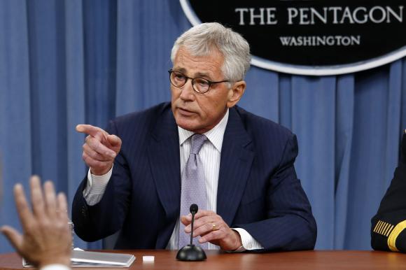 Menteri Pertahanan AS Chuck Hagel berbicara dalam konferensi pers di Pentagon di Washington, 21 Agustus 2014.